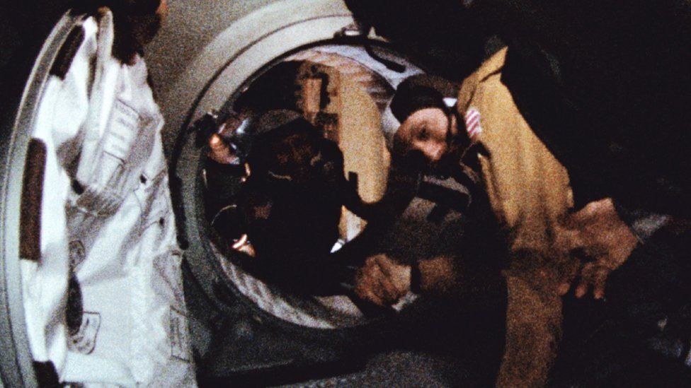 The historic handshake between Leonov (L) and Stafford (R)