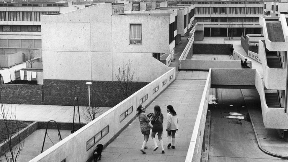 May 1972: Thamesmead housing project, a GLC venture. Pedestrians on the walkways that connect the flats, in Abbey Wood, South London