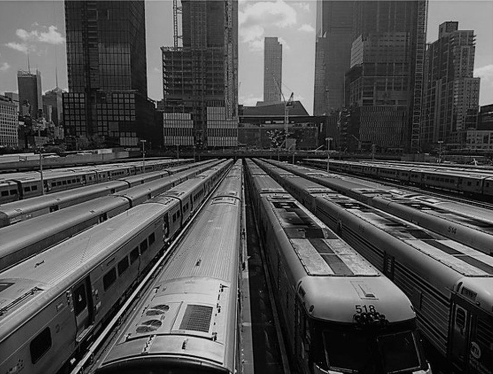 Trains are pictured parked in the sidings at a station in New York City
