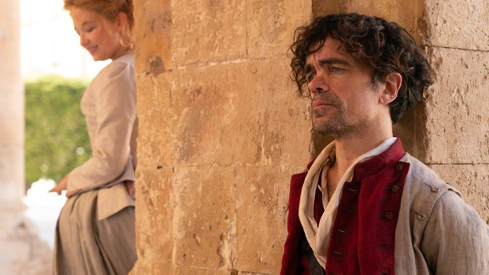 Haley Bennett stars as Roxanne and Peter Dinklage as Cyrano in Joe Wright's Cyrano