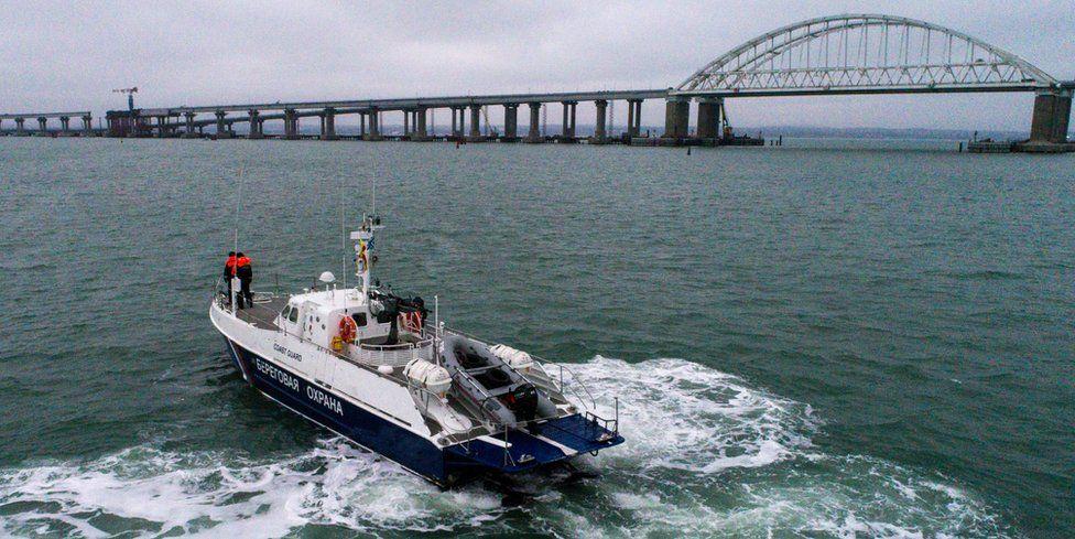 A Russian coastguard boat patrols near the Kerch Strait bridge
