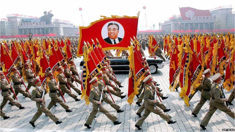 This 25 April 2007 picture, released from Korean Central News Agency 26 April, shows North Korean soldiers, carrying a large portrait of late North Korean leader Kim Il Sung