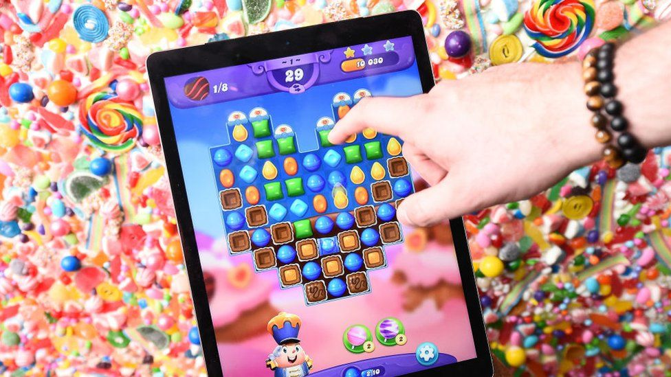 A person playing Candy Crush
