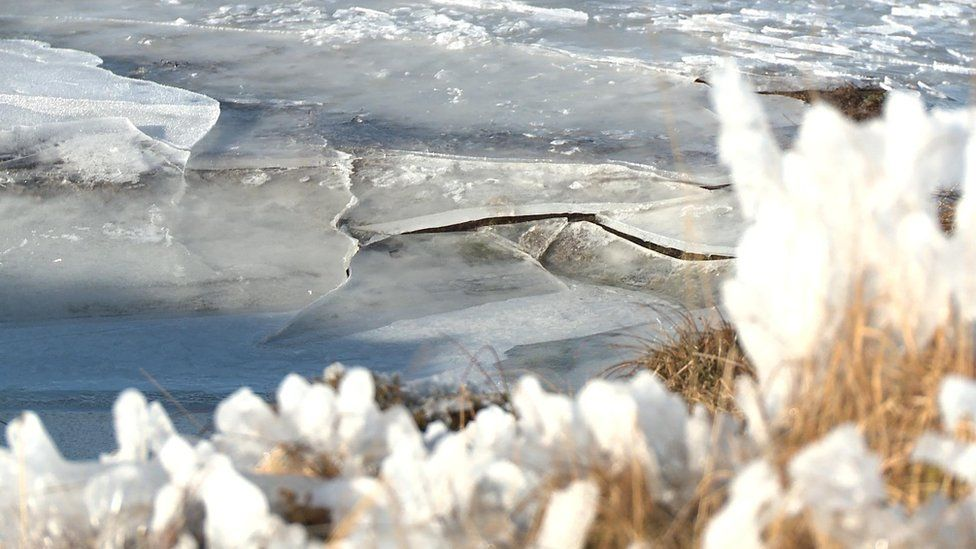 The ice crack at Daer Reservoir near source of the River Clyde