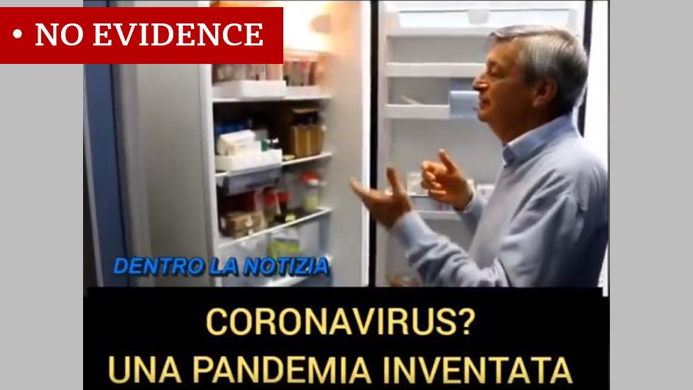 Screenshot of clip with Italian researcher Stefano Montanari looking into a fridge. Caption reads: Coronavirus? A fake pandemic