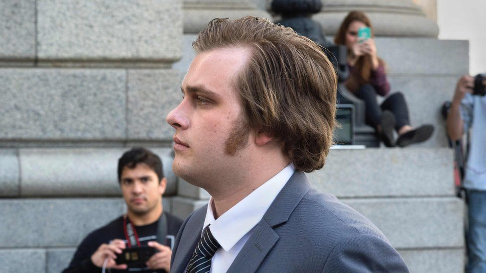 Henri van Breda exits from the Western Cape High Court, after the start of his trial for allegedly killing his two parents, and brother, and wounding his sister, with an axe, in their luxury home, on March 27, 2016, in Cape Town