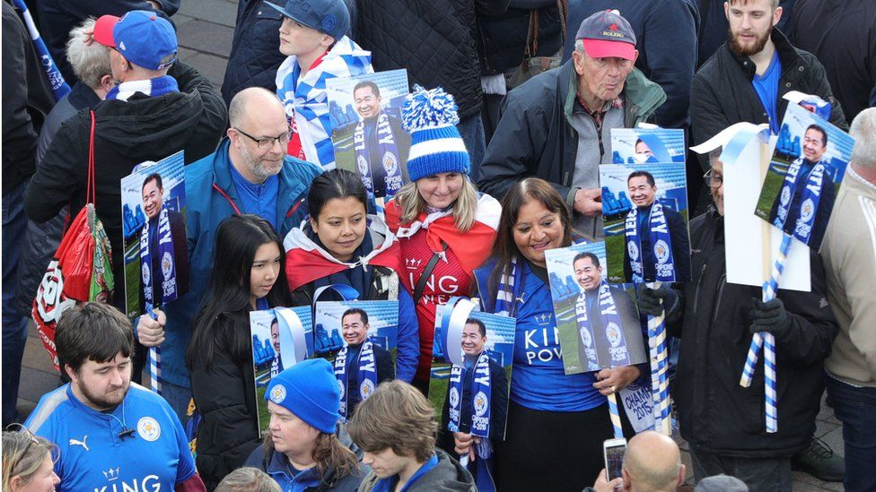 Fans with pictures of Vichai Srivaddhanaprabha