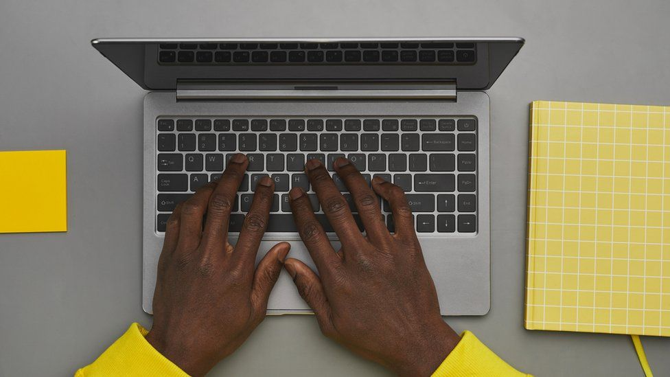 Person with hands on a keyboard