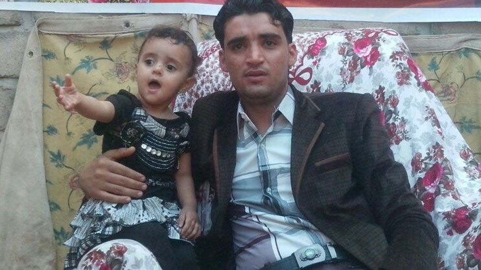 Yunus - one of Abdullah's sons with his two year old daughter Duaa