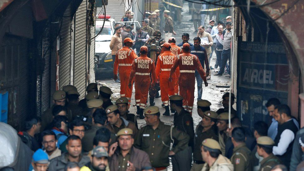 """Members of India""""s National Disaster Response Force (NDRF) head towards the site of the fire"""