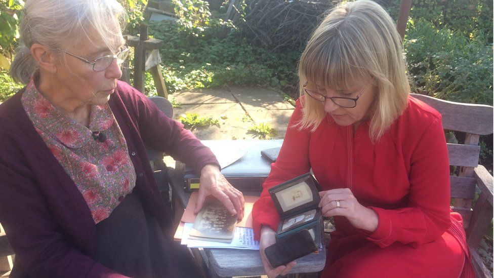 Alison Tyas (left) and Fiona Davison (right) looking at old photos