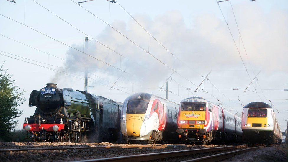 The Flying Scotsman and Virgin Trains' new Azuma travel in the same direction alongside two of the rail operator's present day fleet