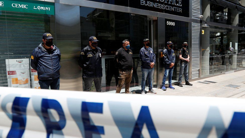 Police officers stand guard outside the building where Leopoldo Luque, the personal doctor of late Argentine soccer legend Diego Armando Maradona, has his office in Buenos Aires, Argentina November 29, 2020.