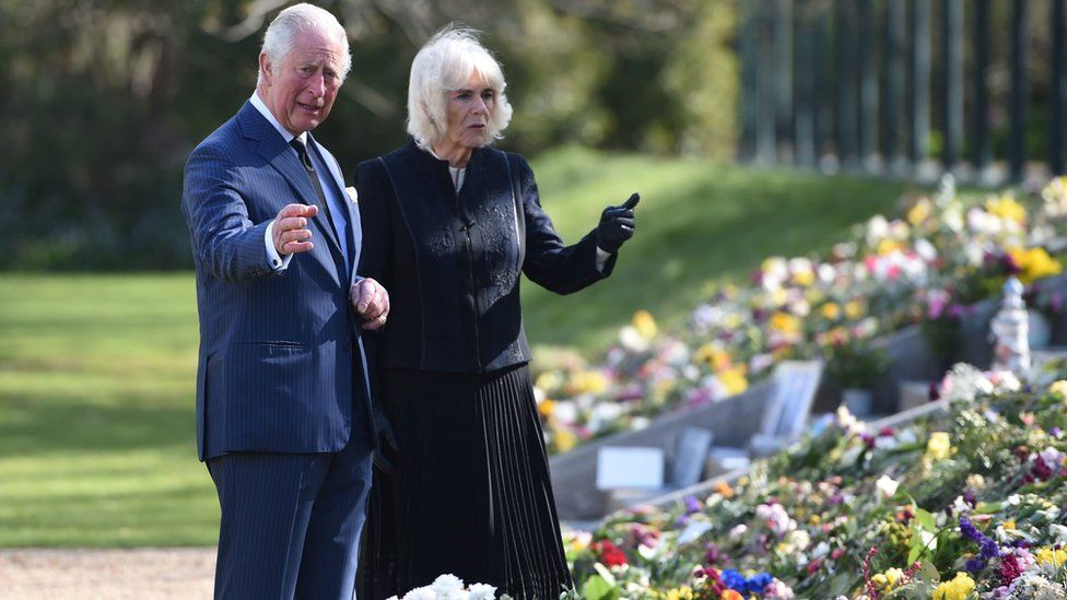 The Prince of Wales and Duchess of Cornwall view flower tributes to Prince Philip at Marlborough House, London, on 15 April 2021