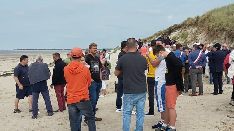 People gathered on Armanville beach in Normandy