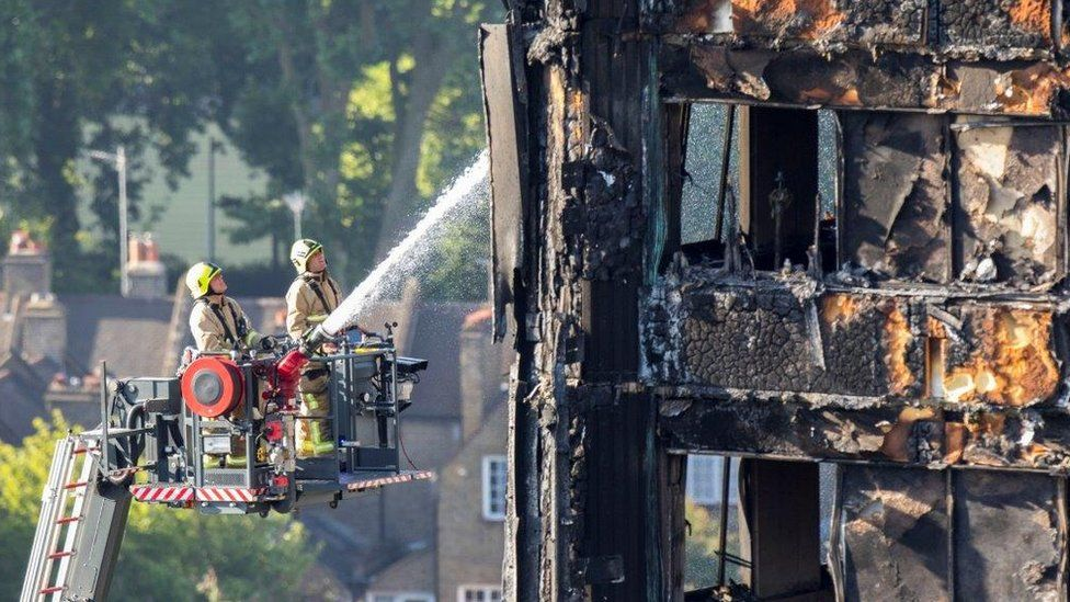Fire crew damps down in aftermath of fire