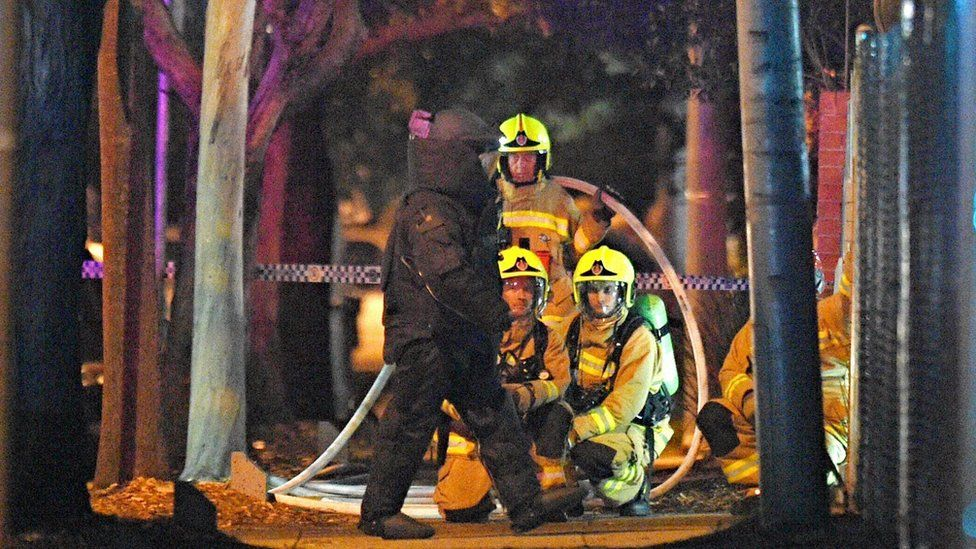 Firefighters and a bomb disposal squad member in Merrylands, Sydney, 21 July