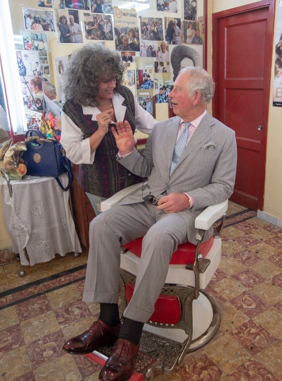 Prince Charles sat in the Barbers chair