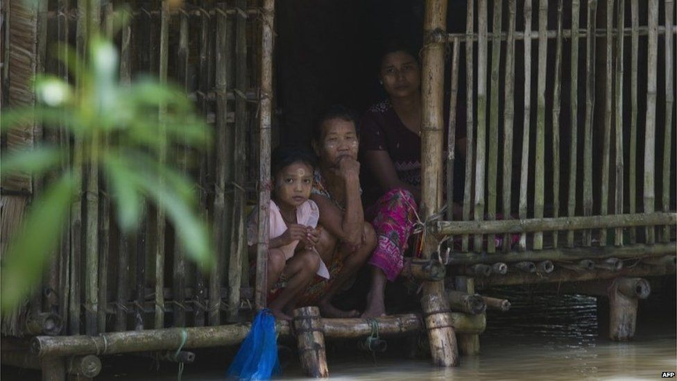 A family look out at floods from their home in Nyaung Do, Myanmar (7 Aug 2015)