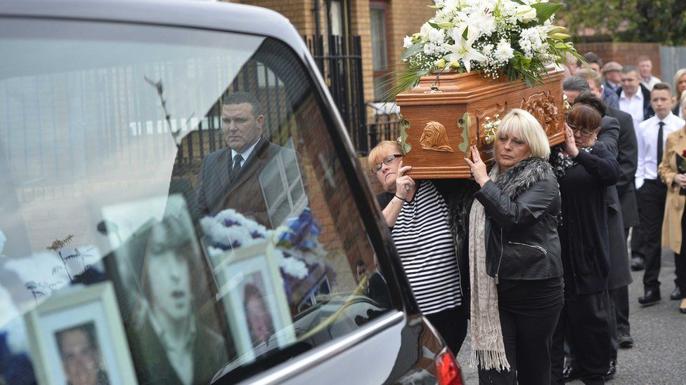Kevin McKee's family carry his coffin towards St Patrick's church in Belfast