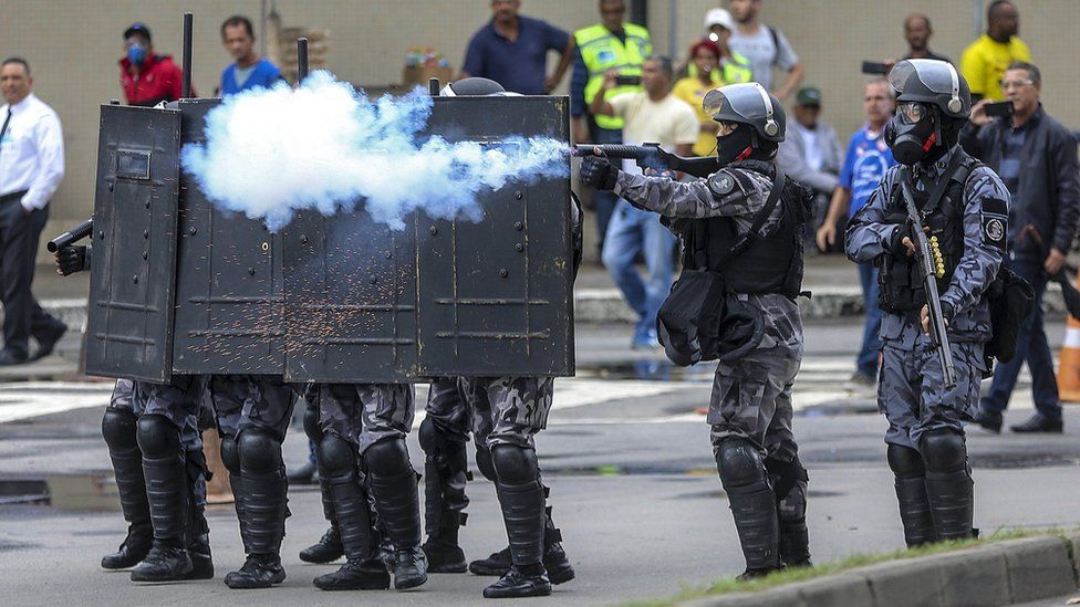 Police try to unblock a street in Rio de Janeiro