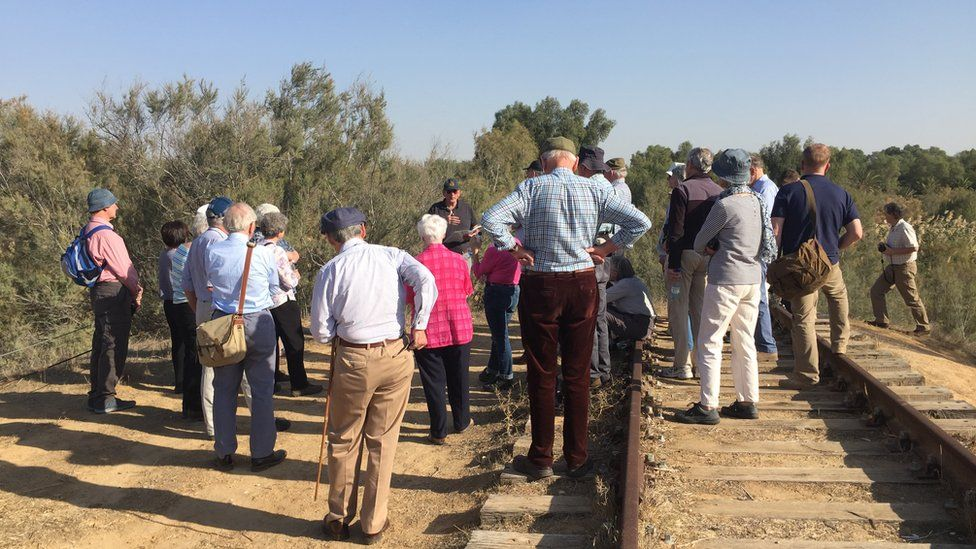 British tour group at railway remains