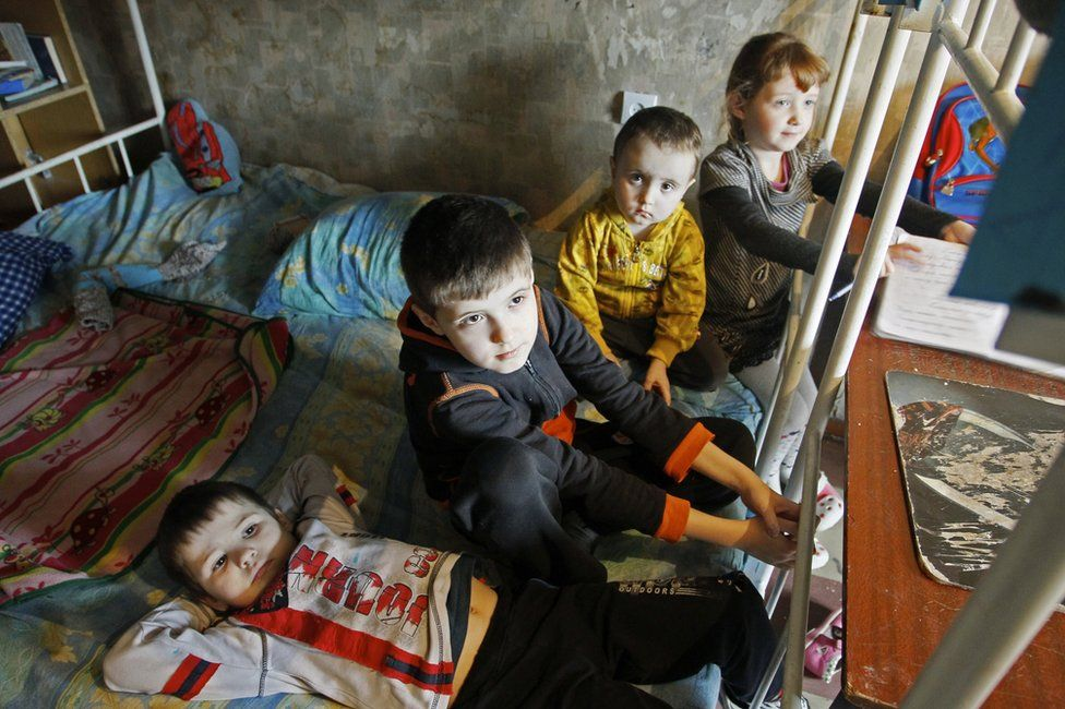 The Shevchenko children play in a hostel room after being evacuated from their home in a Donetsk suburb after shelling, 2 February