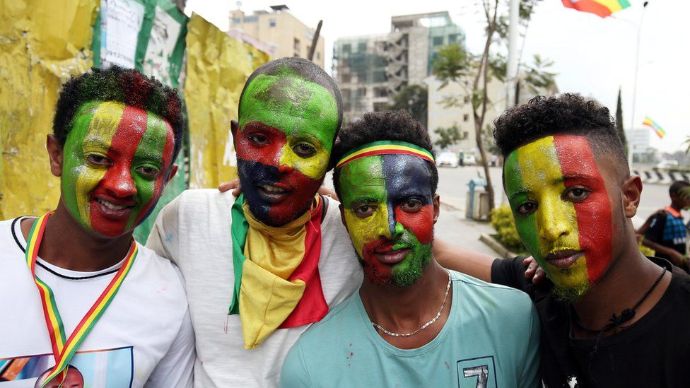 Residents with Ethiopian national flag painted on faces - 14 July