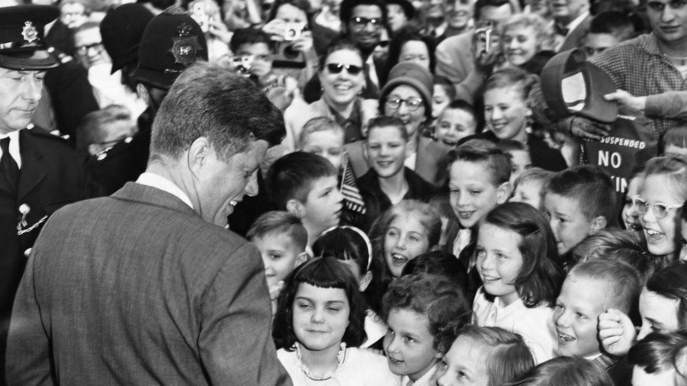 President Kennedy greets British children as he arrives at the American Embassy in London, in 1961