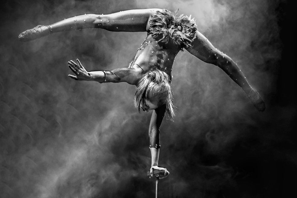 "Photo of an acrobat, titled ""Hand Stand"" - voted first in Advanced Open Projected and overall Best Projected Image"
