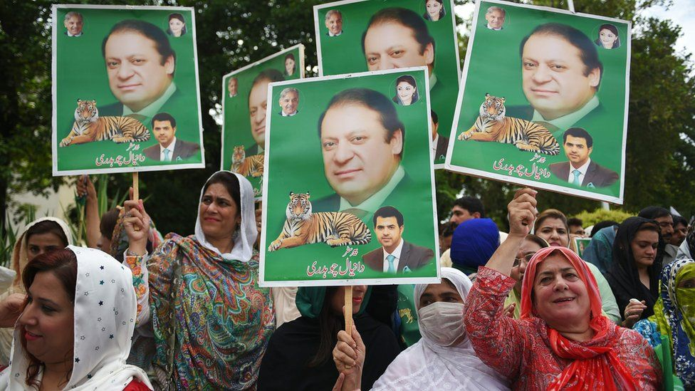 Supporters of Pakistani opposition parties carry placards with the picture of ousted Pakistani Prime Minister Nawaz Sharif outside the election commission office against the alleged election rigging in Islamabad on August 8, 2018.