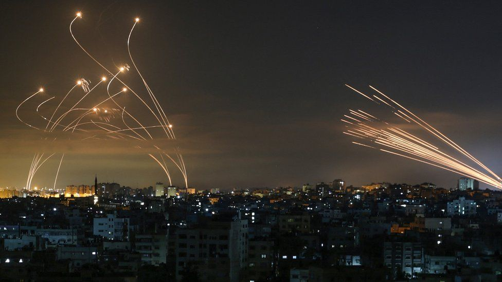 Rockets are seen in the night sky fired towards Israel from Beit Lahia in the northern Gaza Strip on May 14, 2021