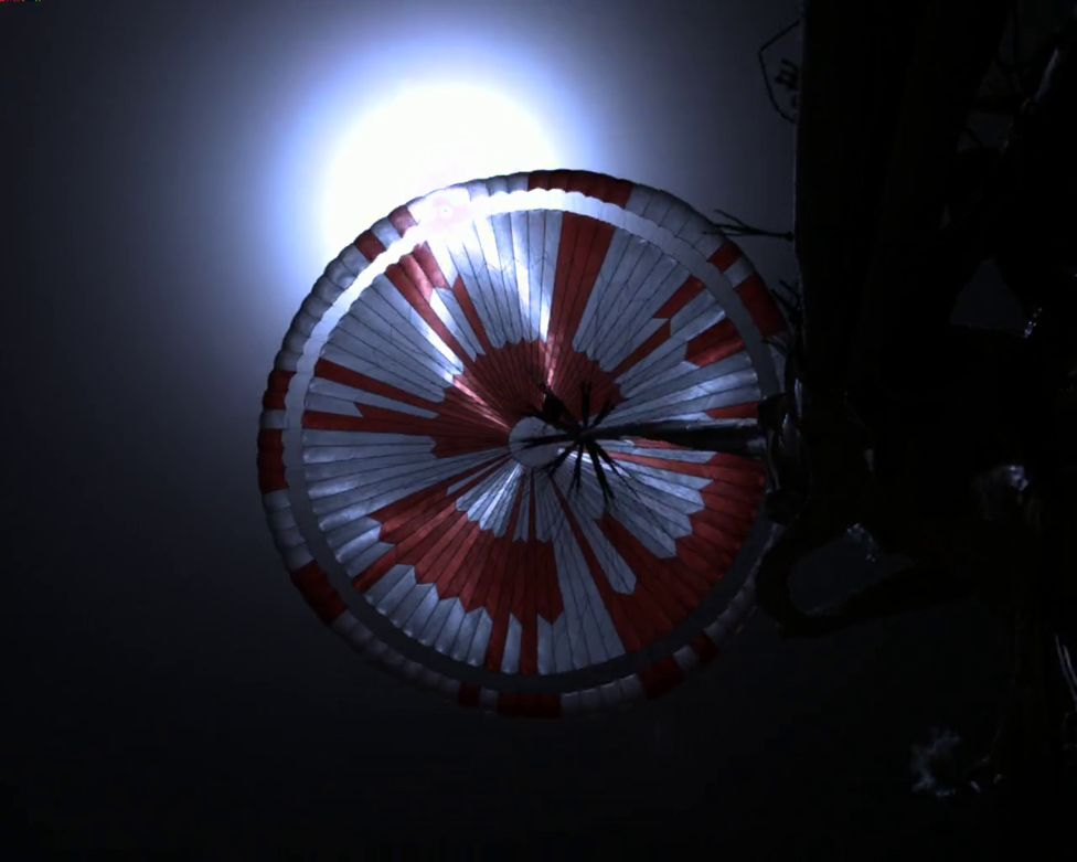 Parachute shot from the spacecraft's backshell during descent