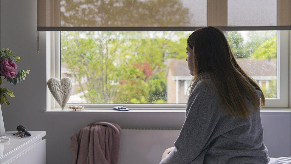 Girl alone in bedroom