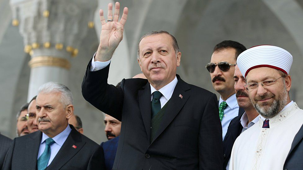 Turkish President Tayyip Erdogan greets people during the opening ceremony of a mosque in Ankara, Turkey, October 27, 2017