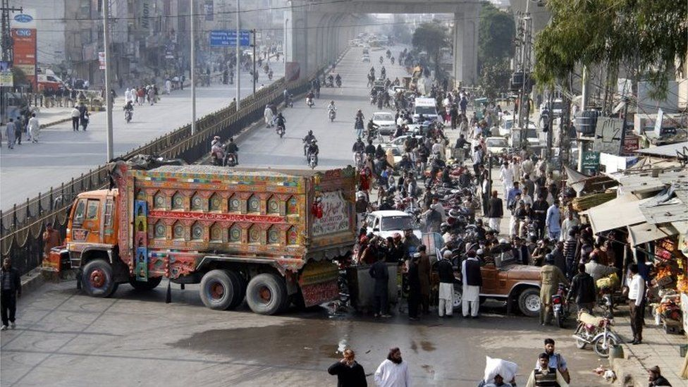 Protestors block a road linking to Islamabad, to protest the execution of former police guard Mumtaz Qadri, after he was hanged to death in Rawalpindi, Pakistan, 29 February 2016.