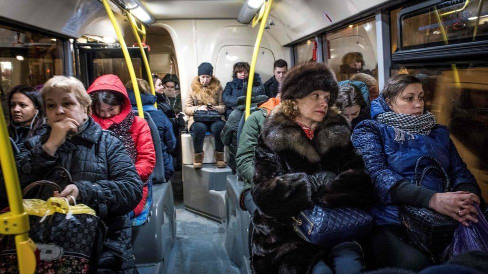 Unhappy people sitting on a bus in Moscow