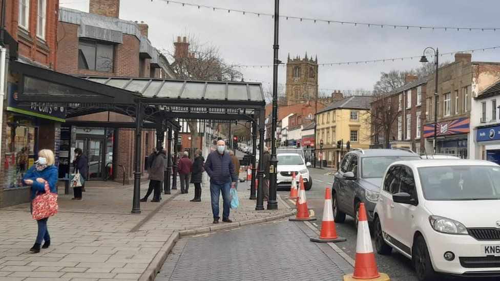 Shoppers on Mold High Street