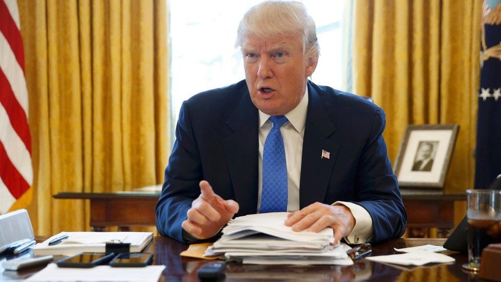 US President Donald Trump is interviewed by Reuters in the Oval Office at the White House in Washington