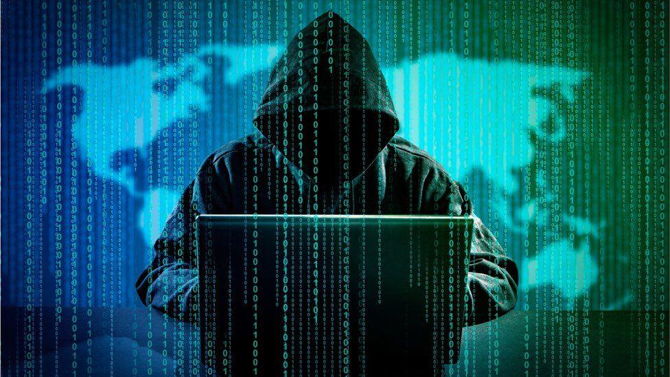 Hacker using laptop (image posed)