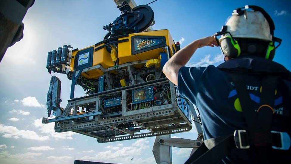The remotely operated vehicle SuBastian is moved into position on the research vessel