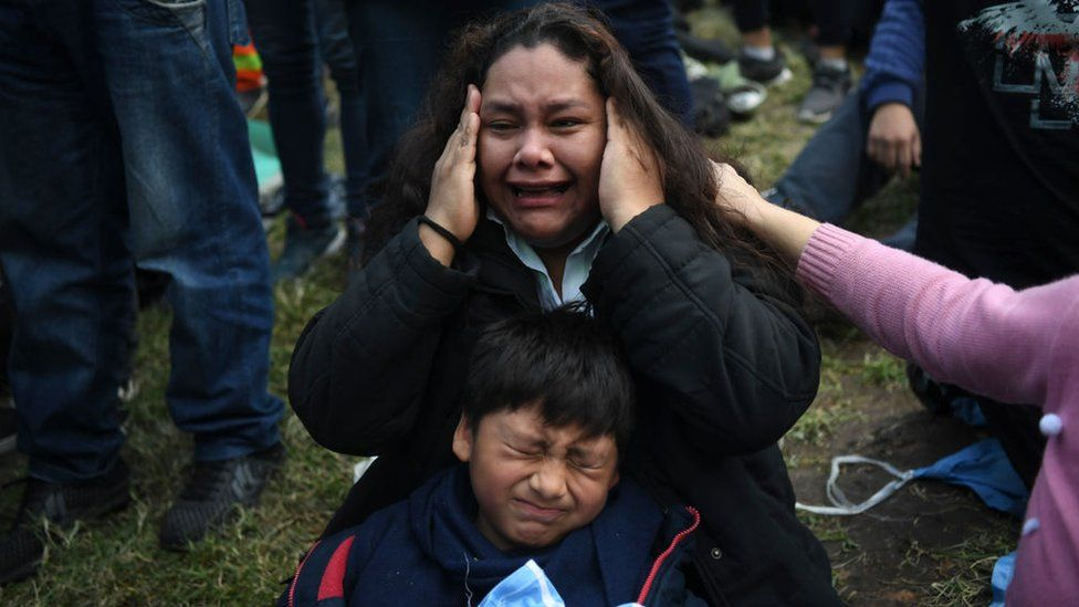 Mother and son cry in Buenos Aires.