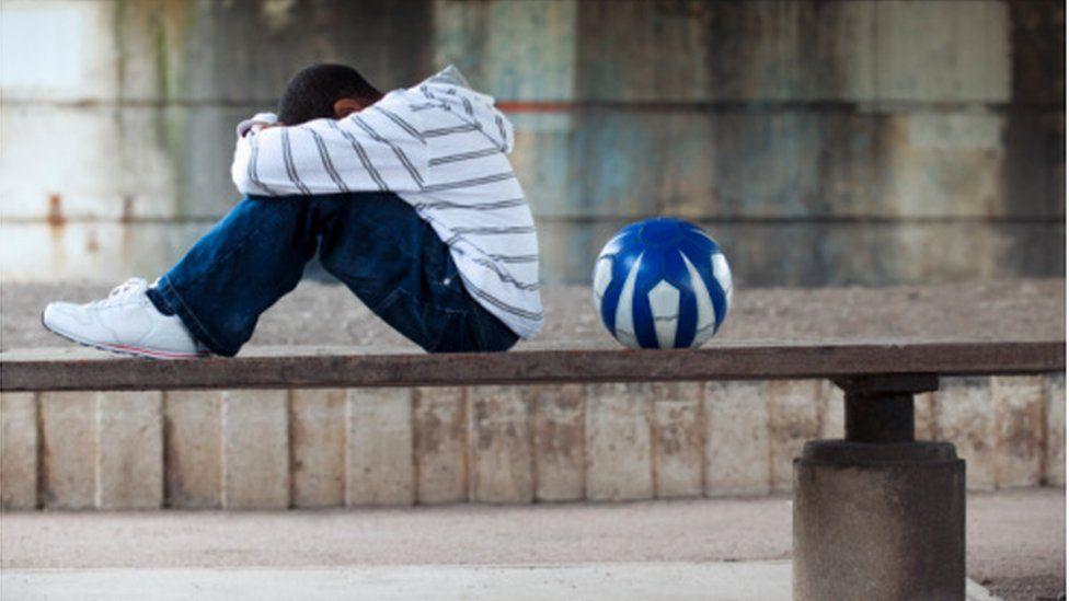 sad boy with ball
