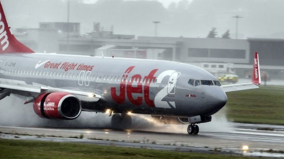 A plane lands in torrential rain at Leeds Bradford Airport