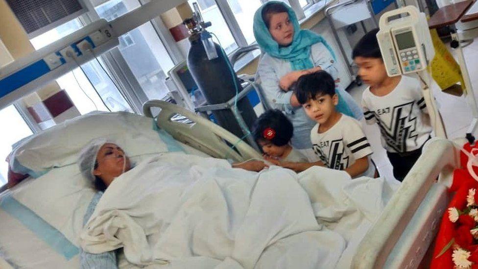 Saba Sahar lies in a hospital bed