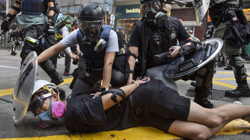 Police hold down a detained protester in Hong Kong (1 Oct 2019)