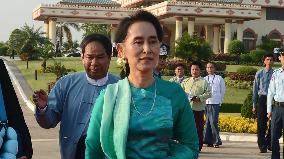 Myanmar State Counsellor and Foreign Minister Aung San Suu Kyi prepares to depart with President Htin Kyaw