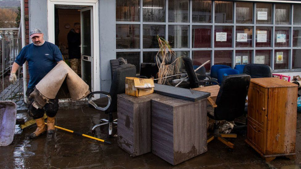 Furniture and carpets outside a community shop and hub in Nantgarw