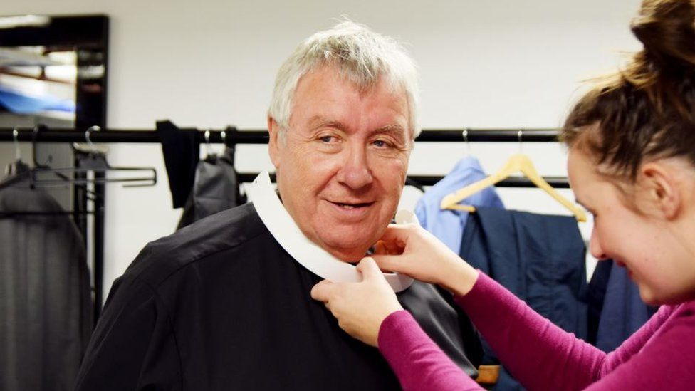 Gregor Fisher tries on the dog collar