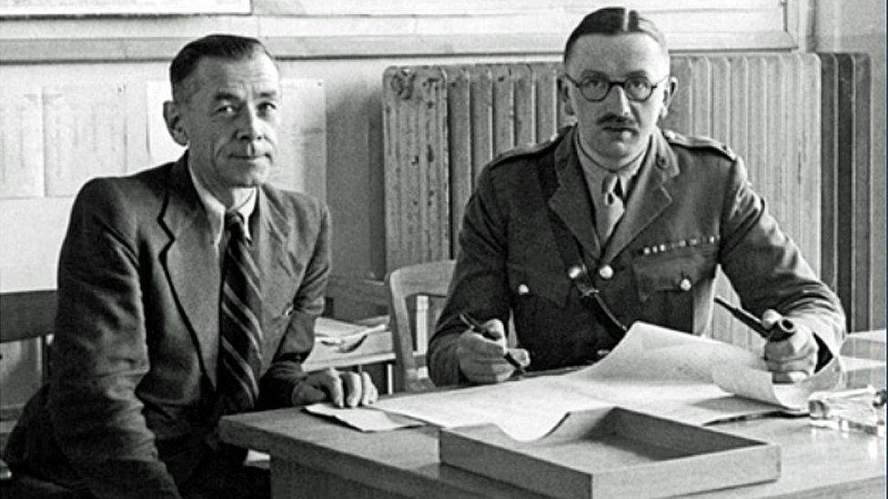 Major Ivan Hirst (right)